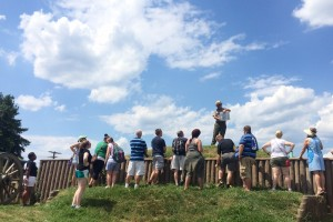 Group of 20 teachers at Fort Stevens in Washington, D.C. A National Parks Service ranger speaks to the group.