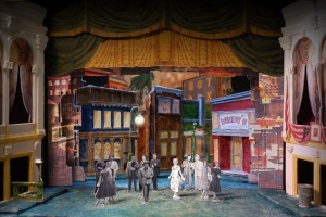 "Scenic design for Ford's Theatre ""Guys and Dolls"" by Court Watson features a 1950s Times Square in bright, primary colors."
