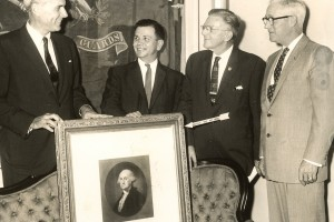 Photo from 1959 shows Addison Reece standing with three other men in business suits above the original George Washington portrait, the sofa from the Presidential Box. Behind them is the original blur Treasury Flag from Ford's.