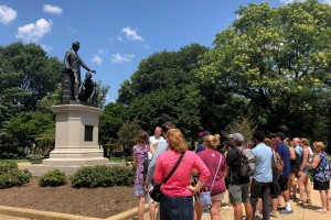 A group of teachers visit Washington, D.C.'s Emancipation Memorial in Lincoln Park.