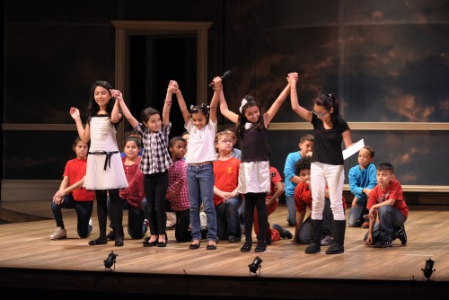 Students on the Ford's Theatre stage take a bow after performing at the Oratory Festival.