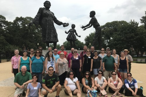 Teachers pose in front of the Mary McLeod Bethune Statue in Lincoln Park.