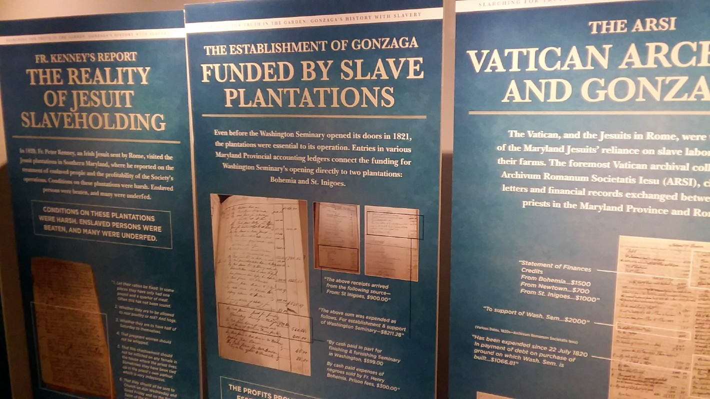 Blue presentation panels line the walls of the Center for Education and Leadership. On the panels is information researched by Gonzaga College High School about their institution's connections to slavery.