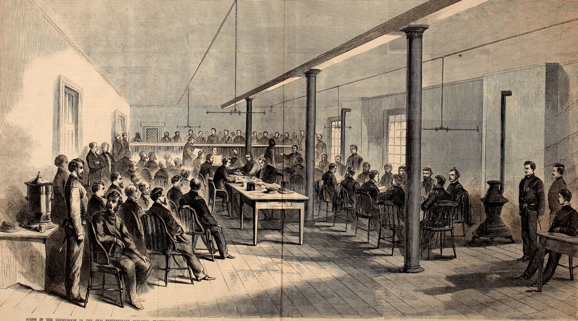 Illustration of more than 30 men gathered around tables and dozens more standing in a nearby gallery during the military tribunal for those accused of conspiracy in the Lincoln assassination.