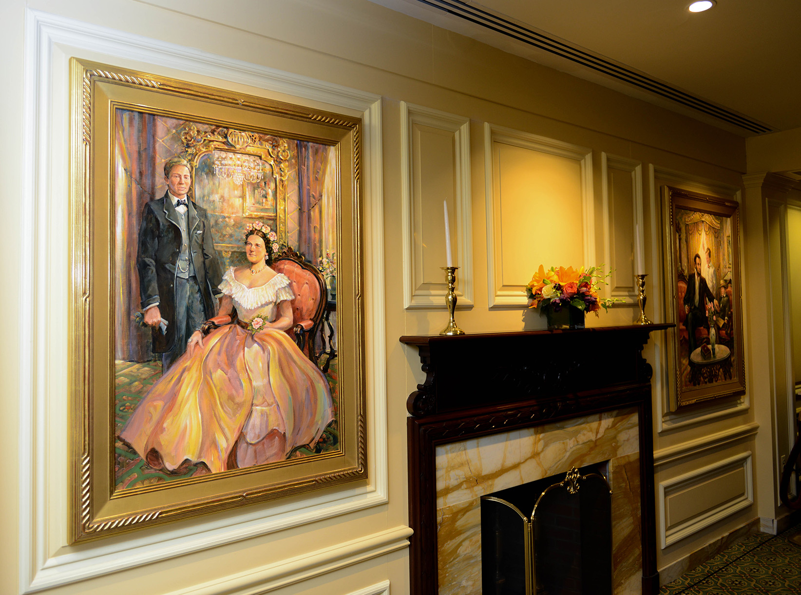 A painting of Abraham and Mary Lincoln hangs near a fireplace in the lobby of the Willard Hotel in Washington, D.C.